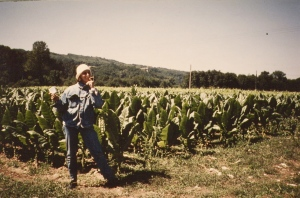 smoking a cigaret in a tobacco field near Paris